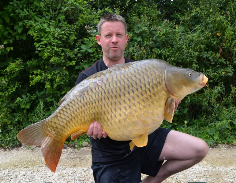 Stefan with the Lake Record Common at 44lbs